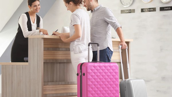 Couple checking into a hotel with high density access points